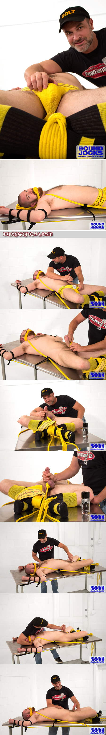 Silver Daddy edges his bear cub who's tied to a table in nothing but a yellow jockstrap and rugby socks.