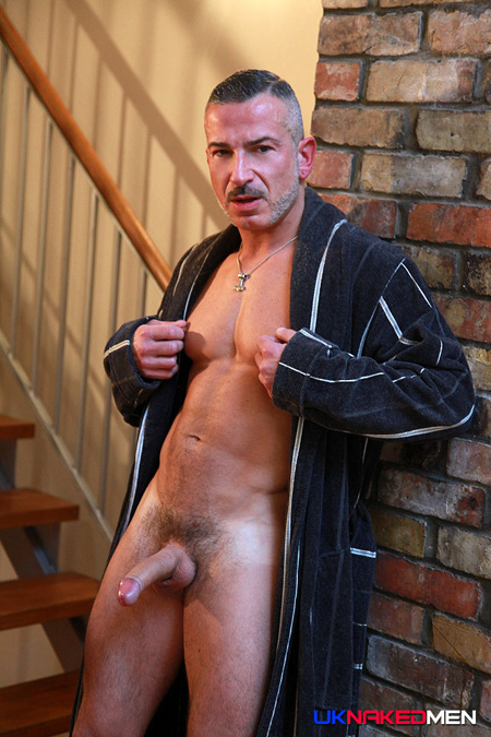 Silver muscle Daddy exposing his erection from his open robe.