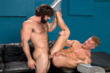 Two muscular studs, one hairy, one smooth, having gay anal sex.