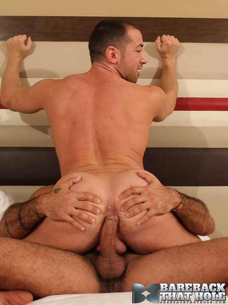 Muscular stud being fucked in the ass bareback.