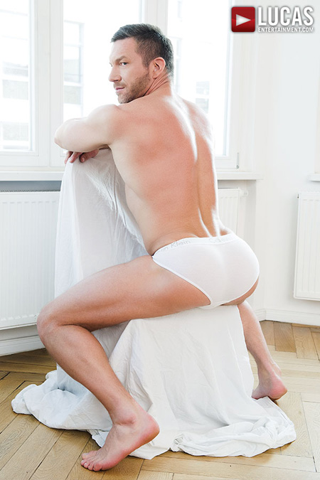 Smooth, muscular Daddy displaying his bubble butt in tight white briefs.