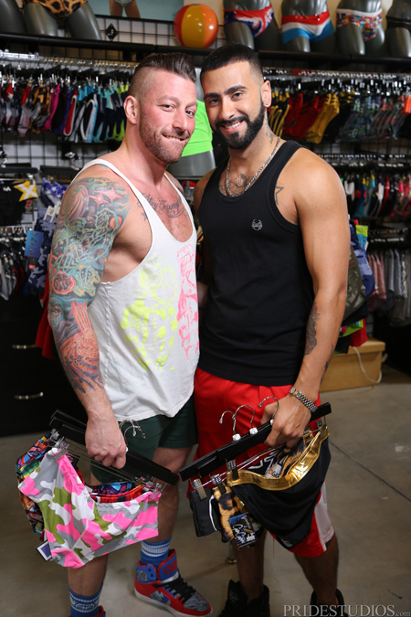 Muscle men in tank tops shopping for Speedos and and underwear together.