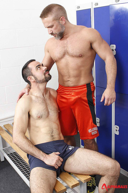 Hairy older men with erections in their workout shorts run into each other in the locker room.