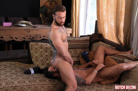 Tattooed, bearded stud sitting on the face of a horny muscle Daddy.