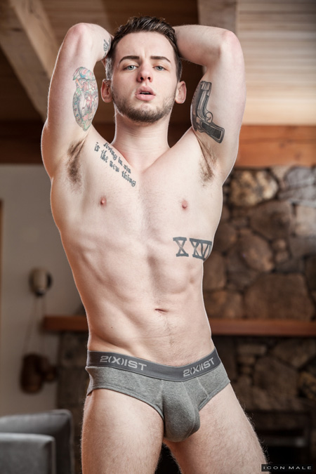 Twink hunk in tight grey briefs showing off his big muscles and unusual tattoos.