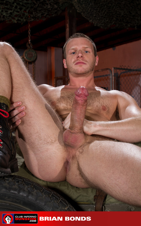 Dirty blonde man in black boots showing off his huge erection.