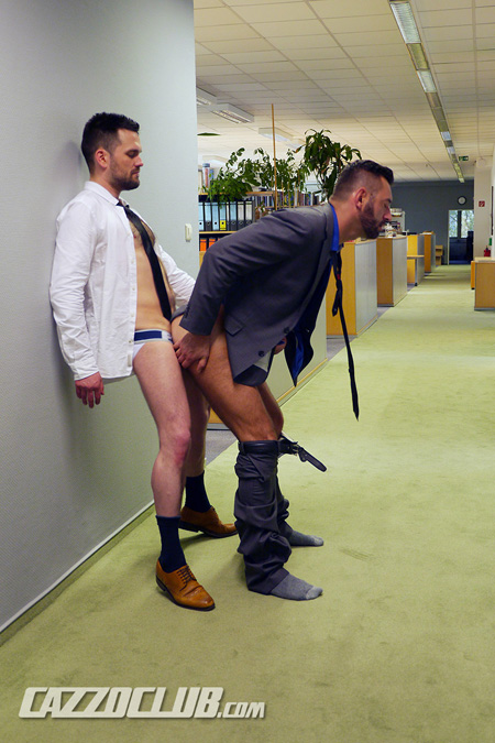 Hairy German office workers in suits having anal sex in the hallway of their office building.