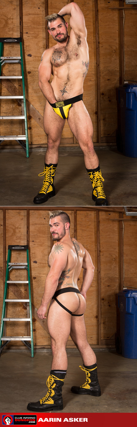 Scruffy muscle hunk Aarin Asker in leather boots and a jockstrap.