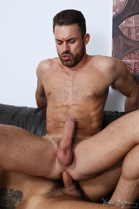 Scruffy muscle stud sitting down on a huge raw cock.