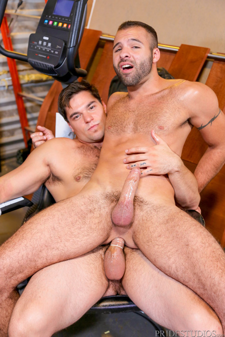 Two guys having gay sex in a storage unit.