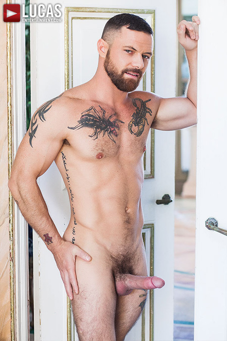 Muscular Sergeant Miles standing in an open doorway nude with an erection.