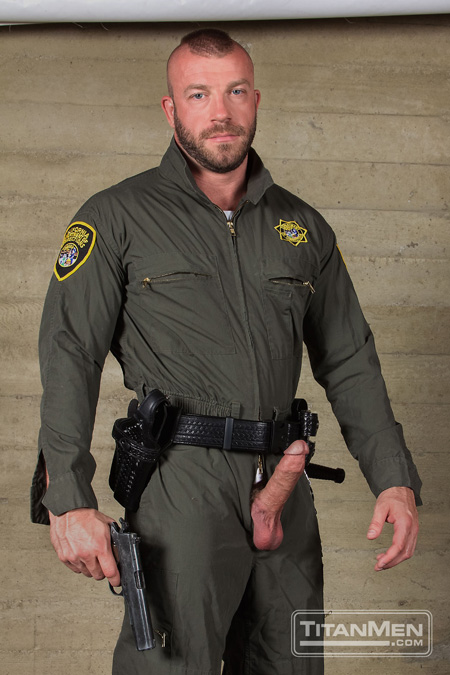 Uniformed corrections officer with a erection poking out of his trouser fly.