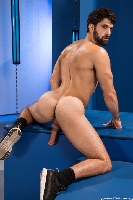 Muscular nude athlete showing off his bubble butt and hard dick.