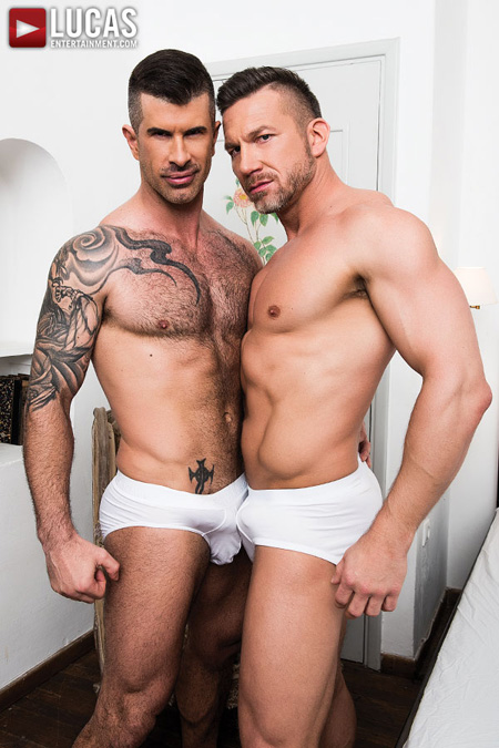 Muscular men with huge hard-ons in their white briefs.