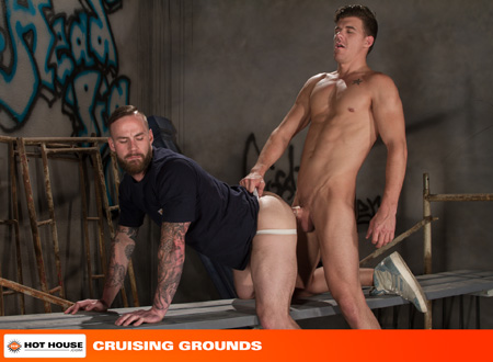 Muscle cub in a jockstrap getting fucked in an alley by a nude, muscular man.