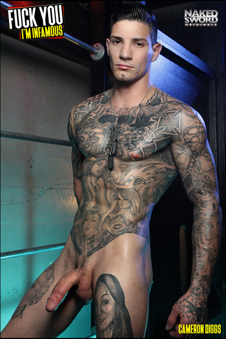 Heavily tattooed muscle hunk nude with his big dick semi-erect.