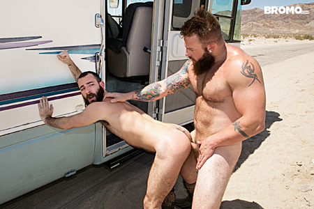 Hairy men fucking rough bareback on the side of the road.