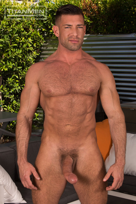 Well-hung nude man with a huge erection.