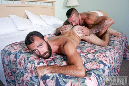 Bearded otter getting his ass rimmed by a tattooed muscle hunk.