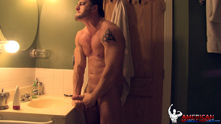 Muscular straight guy jacking his big dick in the bathroom mirror.