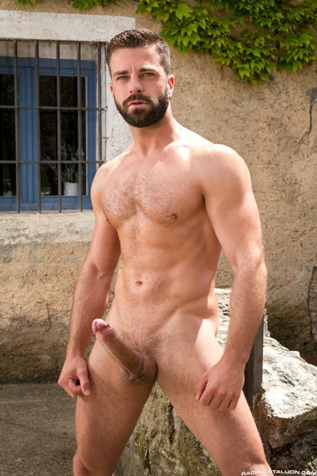 Hairy bearded muscle hunk nude outdoors with a huge erection.