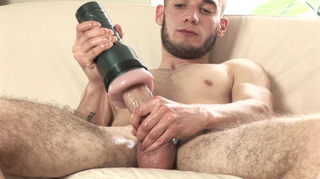 Bearded fit guy stroking his big uncut cock with a Fleshjack.