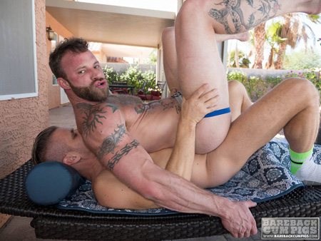 Hairy, bearded jock riding a raw dick outside.