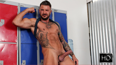 Hung, tattooed muscle Daddy nude and erect.