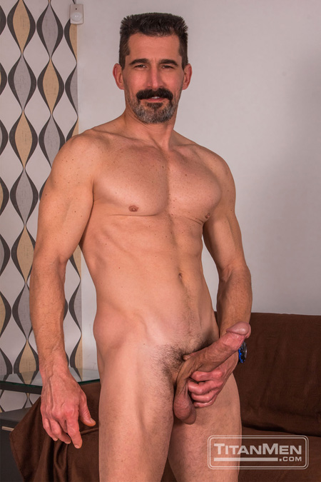 Hung muscle Daddy sporting a huge erection.