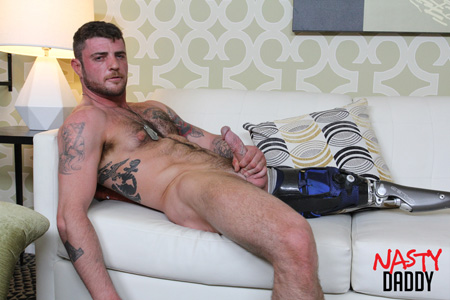 Hairy muscle hunk amputee nude with a hard-on.