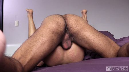 Hairy ass of a Latino muscle Daddy balls deep in a Latin twink.
