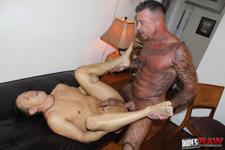 Tattooed muscle Daddy fucking another man with his raw dick.
