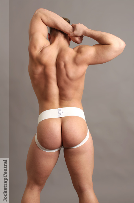 Baseball muscle stud wearing nothing but his jockstrap from behind.