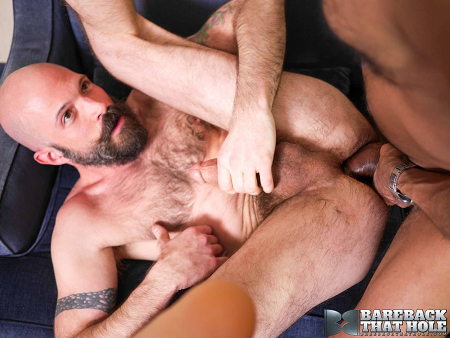 Hairy Daddy taking an enormous black cock bareback.