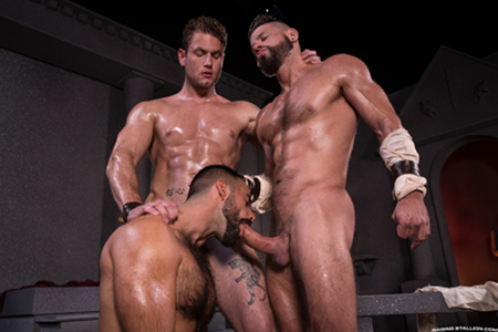 Muscle hunk threesome sucking cock.