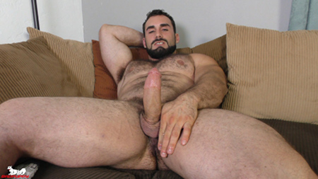 Hairy muscle hunk Jaxton Wheeler lying on the couch nude with a boner.