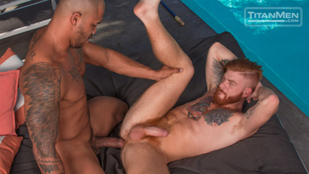 Inked ginger man about to take a huge uncut cock in his ass by the pool.