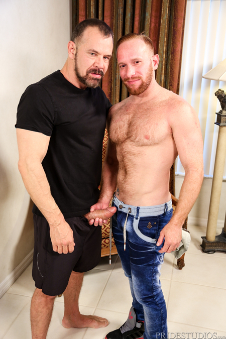 Hairy ginger male grabbing the thick cock of his bearded Daddy.
