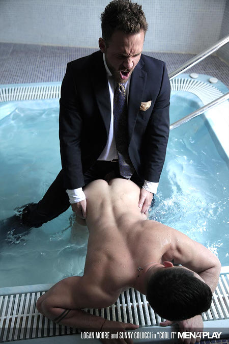 Bearded man fucking a sexy hunk in a Jacuzzi while still wearing his entire business suit.