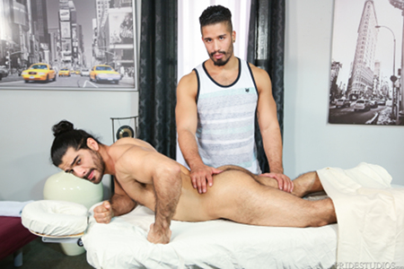 Hairy Arab muscle hunk getting massaged by another man.