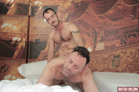 Ripped muscle Daddy fucking another man from behind.