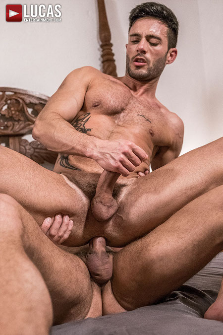 Tattooed muscle hunk sitting on a raw dick while he masturbates.