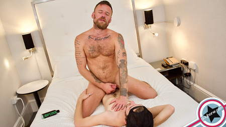 Tattooed cub sitting on a raw dick.