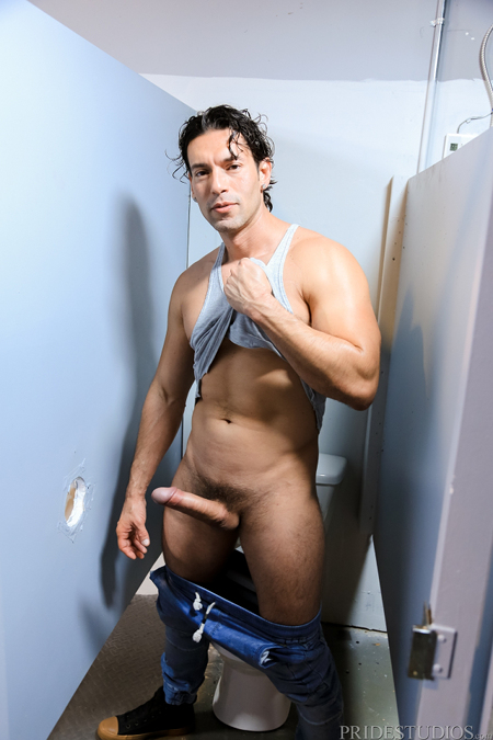 Tall guy with a monster cock at a bathroom stall gloryhole.