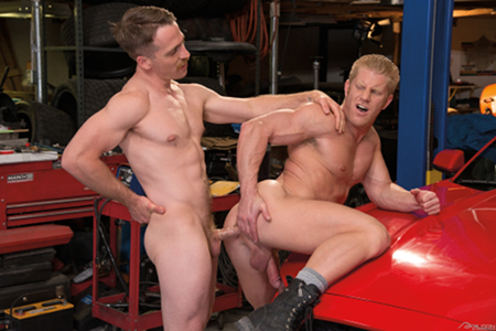 Mustache muscle hunk fucking a redheaded bodybuilder in the ass.