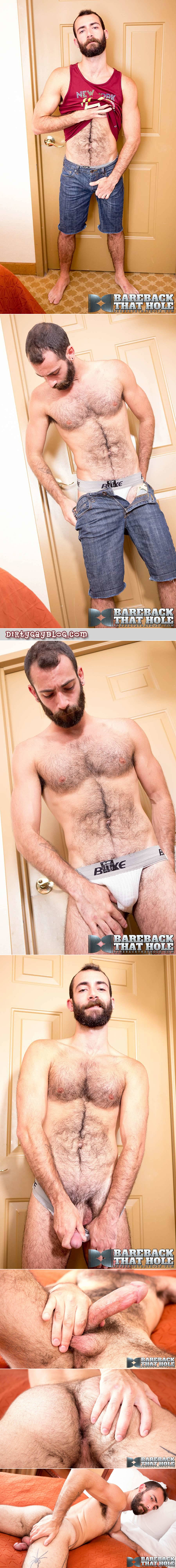 Sexy, hairy otter stripping off his clothes in a hotel room.