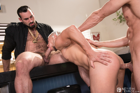 Gay guy getting spit-roasted by two musclemen.