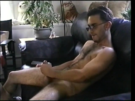 Hairy straight guy masturbating on the couch.
