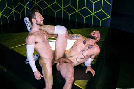 Bearded muscle hunk being fucked by another man.