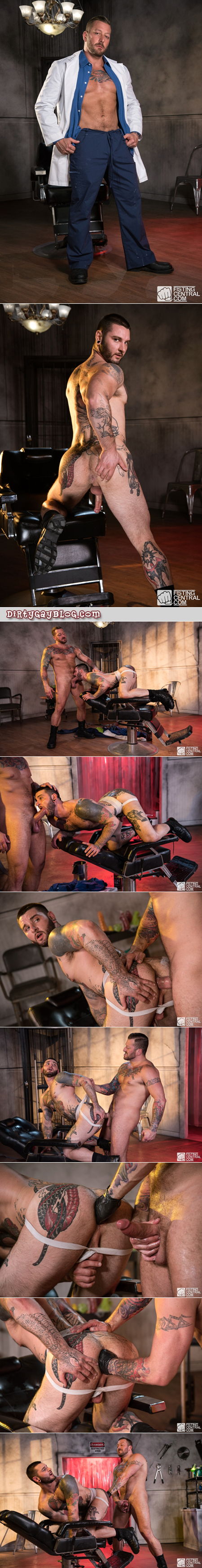 Muscular scientist experimenting on the hole of his tattooed muscular slave.